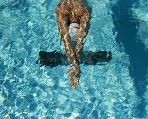 high-angle-of-male-swimmer-in-the-water-pool